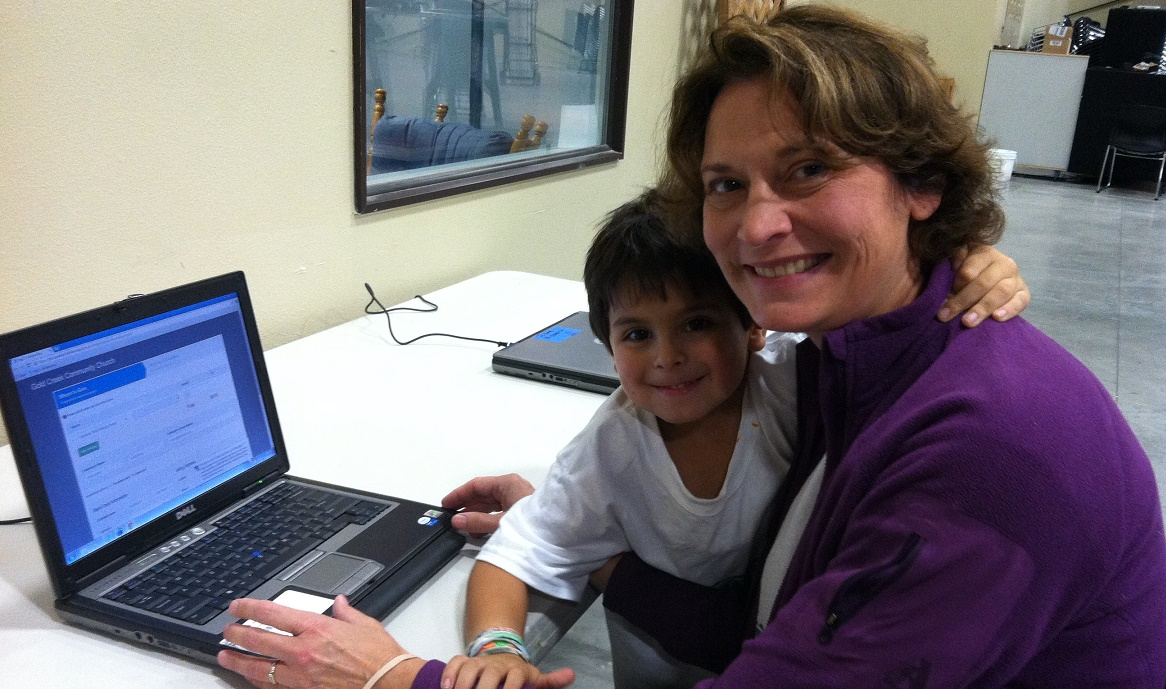 Hope Creek CF volunteer Christine using one of the laptops from InterConnection with her son Cole
