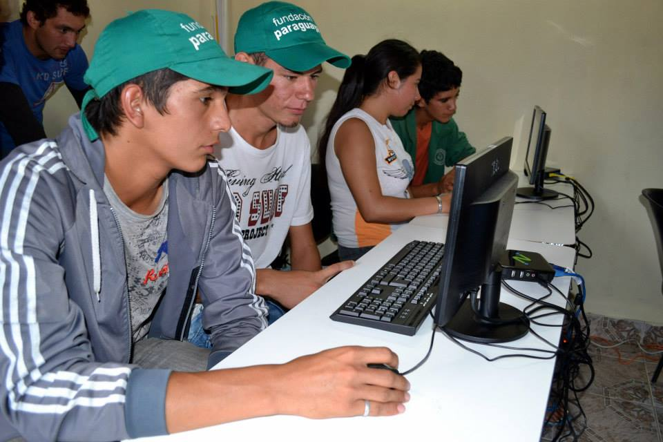 Kids in Paraguay using their brand new computer lab donated by InterConnection
